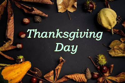 Thanksgiving Day text on black background with dry leafs.