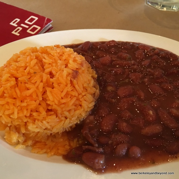saffron rice and red beans at Pio Pio 2 in Jackson Heights, Queens, New York
