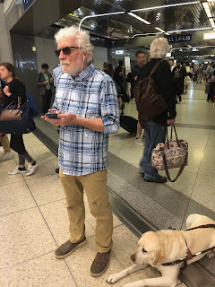 Paul pausing briefly to check his progress on the Loud Step indoor navigation app at Chicago's O'Hare airport