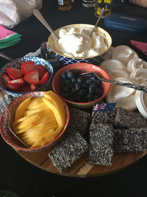 Australia Day dessert platter with meringue nests, lamingtons, strawberries, blueberries, mango slices and whipped cream