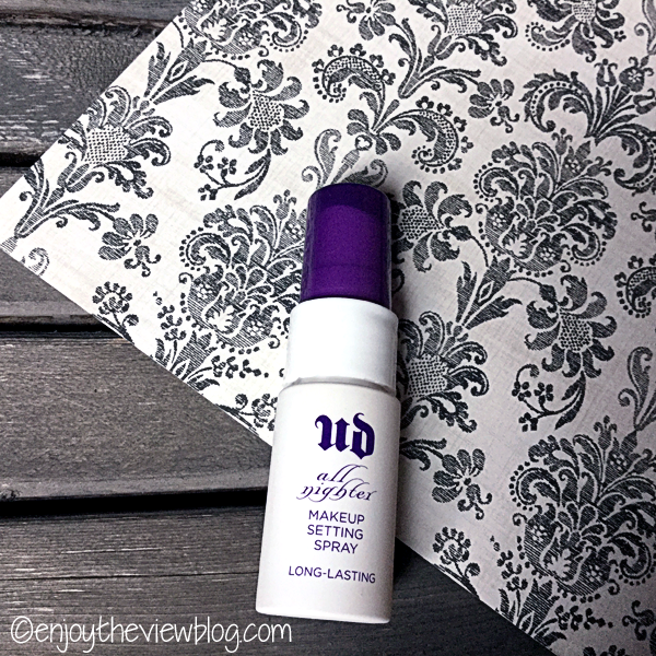 Urban Decay All Nighter Makeup Setting Spray with a black and white print background on a pallet