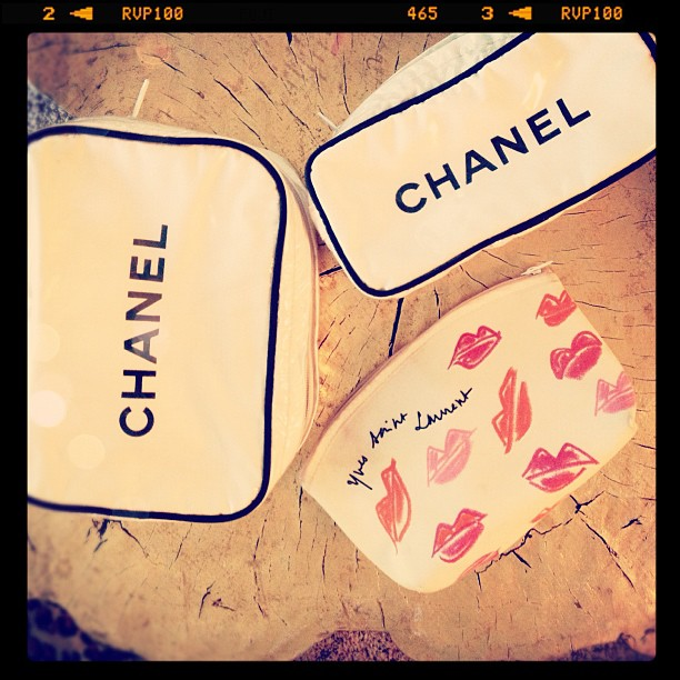 vintage chanel and YSL cosmetic bags