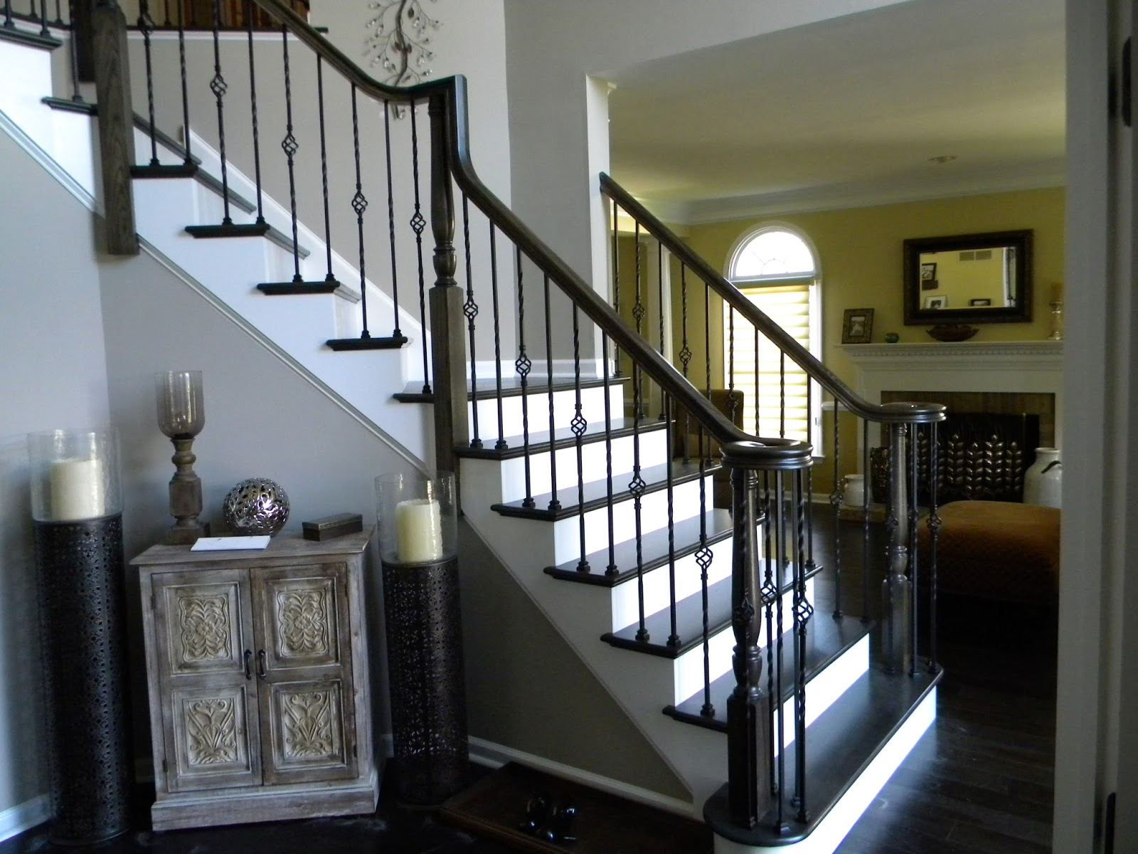 Wood Stairs And Rails And Iron Balusters