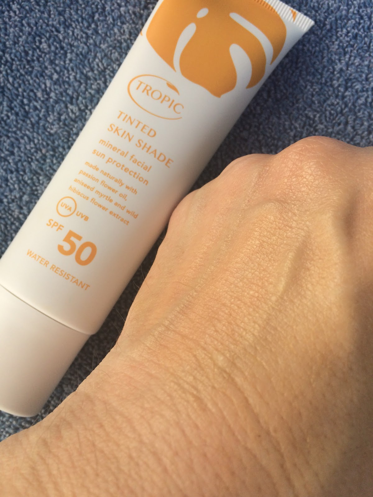 Tropic Skin Care Tinted Skin Shade blended into the hand