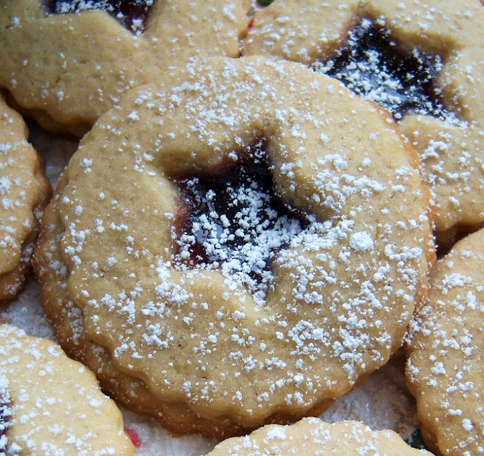 these are a cutout raspberry filled with jam cookies similar to a linzer cookie