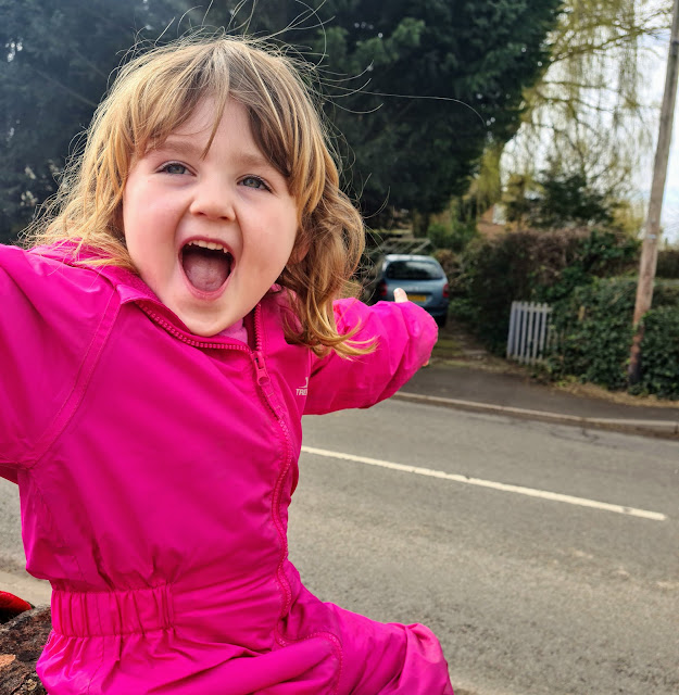 Image of happy young girl in pink all in one suit. Katrina Over 30s UK blogger talking about parenting, autism, mental health, books and coeliac disease. What The Redhead Said Living Arrows UK Parenting Blog Link Up Khalil Gibran Quote