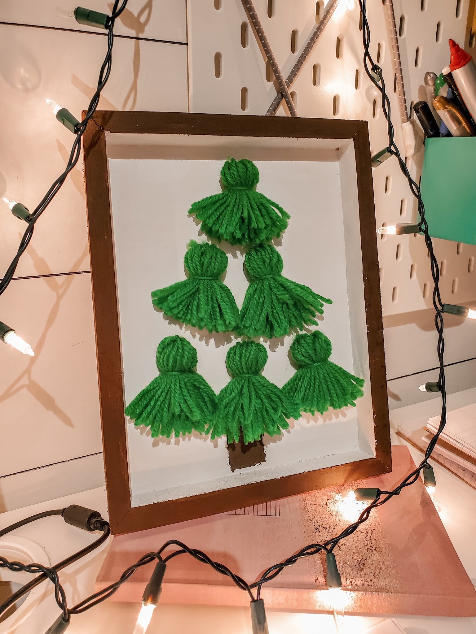 Easy and Fun Christmas Craft by Plaid and Sugar Yarn Tassel Christmas Tree Sign