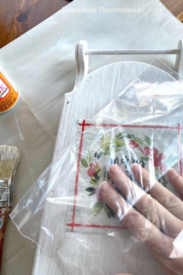 Using Plastic Wrap To Decoupage Napkins