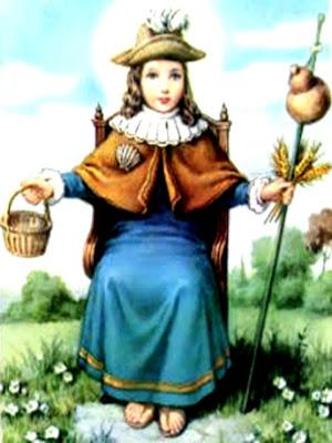 El Santo Niño de Atocha que sostiene en una mano la cesta vacia y en otra el baston de peregrino