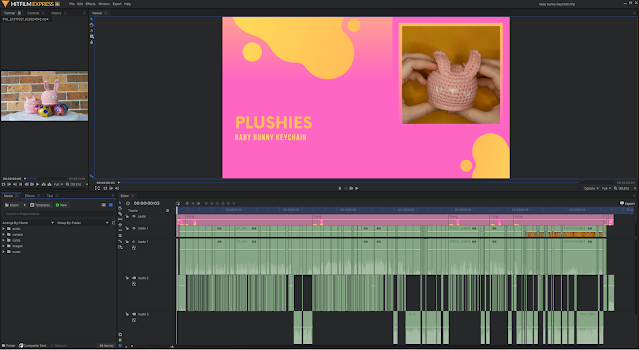 """A screenshot of HitFilmExpress - a film editing software. The main frame shows the start of the video with a card titled """"Plushies Baby Bunny Keychain"""". The bottom of the screen has the timeline with several rows for audio and footage, which have been cut up into many small sections."""
