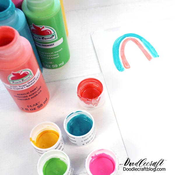 After filling an entire sticker page, set it aside to dry and fill another one! Make multi-colored rainbows with layered arches and dots.