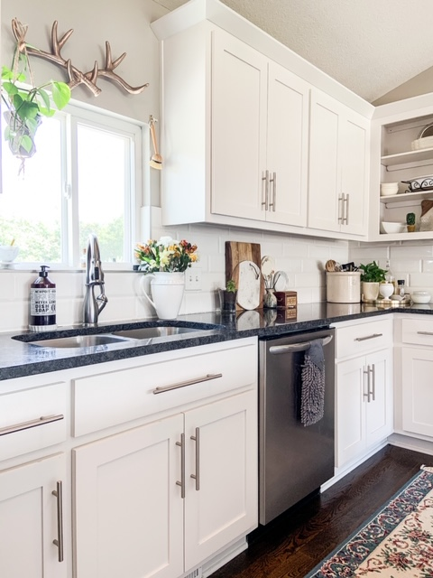 white cabinets black counter