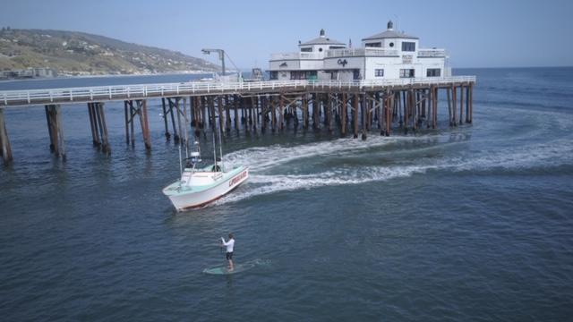 SUP Surfer Handcuffed for Surfing Empty Malibu - The Inertia