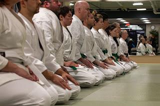 Karate martial artists sitting in a line | Japanese karate association