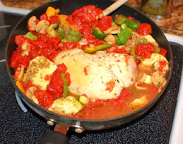 this is a one pan stove top meal called Pork Cacciatore it has peppers, tomatoes and mushrooms in the pan and an Italian classic