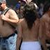 Topless activists parade through New York