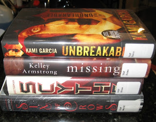 Unbreakable by Kami Garcia, Missing by Kelley Armstrong, Scythe by Neal Shusterman, Six of Crows by Leigh Bardugo