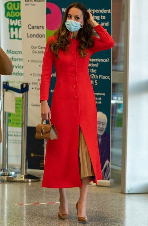 Kate Middleton wore a red coat from Eponine, and a camel pleated skirt. Mappin and Webb Earrings. Demellier London Nano Montreal leather satchel