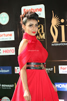 Apoorva in a Stunning Tight Leg Split Sleeveless Red Gown at IIFA Utsavam Awards 22.JPG
