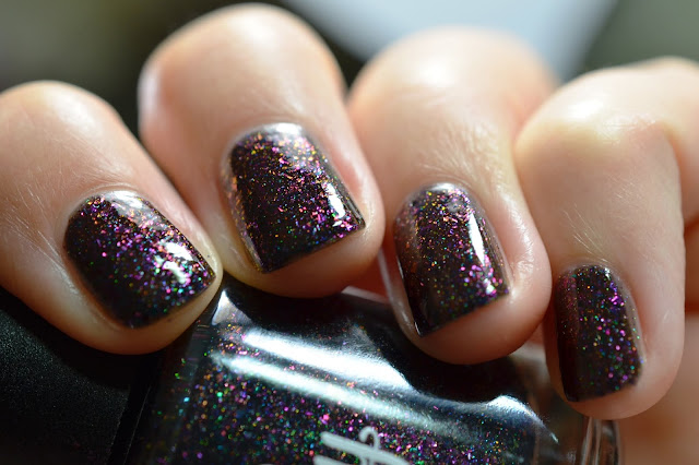 black nail polish with multichrome flakes and holo