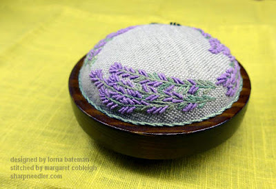 The top of the Lorna Bateman Lavender and Bees pincushion from the back