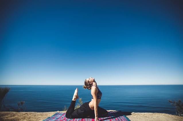 A girl doing yoga on the sea coast