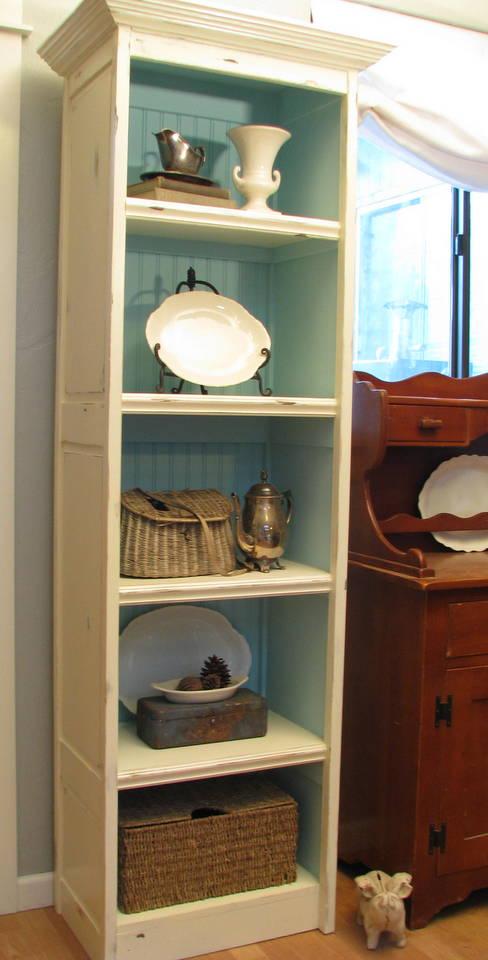 blue roof cabin: Repurposed Bi-fold Doors into Bookcase
