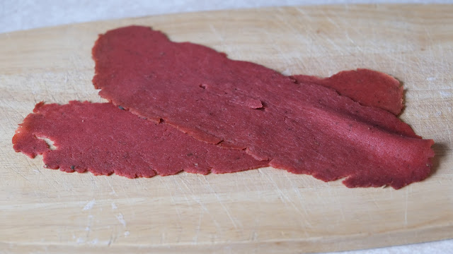 Squeaky Bean Pastrami  on a wooden chopping board