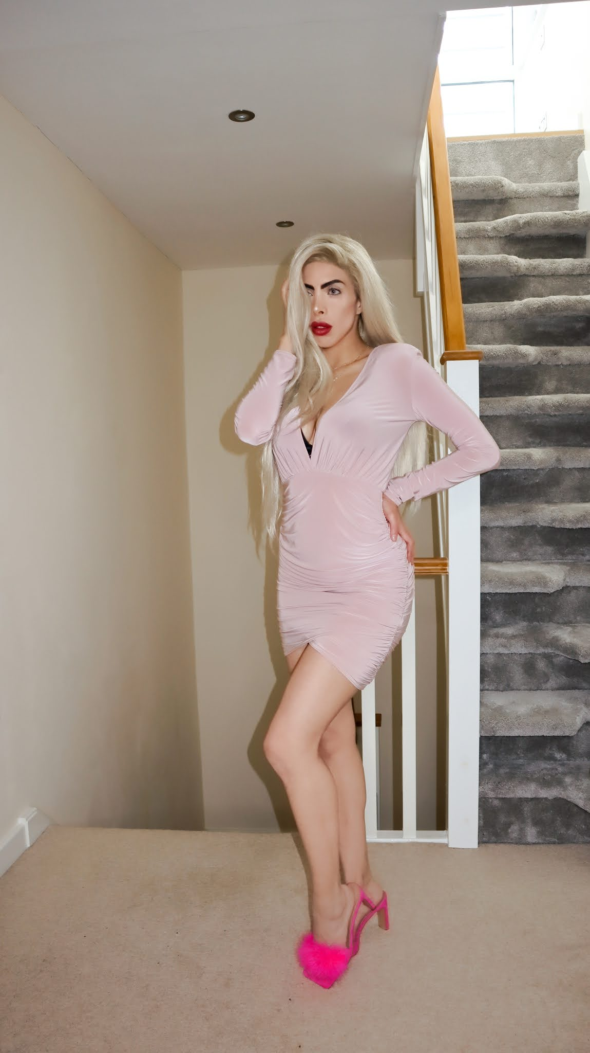 The Femme Luxe Nude Padded Shoulder Slinky Bodycon Mini Dress in model Madison