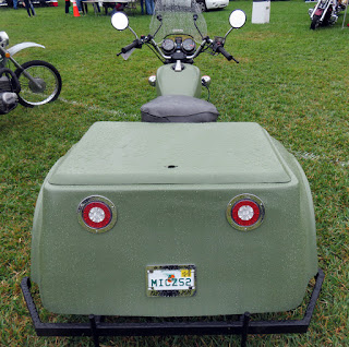 View of motorcycle tricycle from the rear.