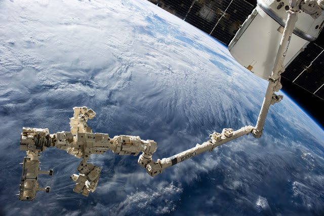 Backdropped against the blue and white Earth, and sporting a readily visible new addition in the form of the Canadarm2. The ISS was photographed following separation from the space shuttle Endeavour. (image: NASA Marshall Space Flight Center)