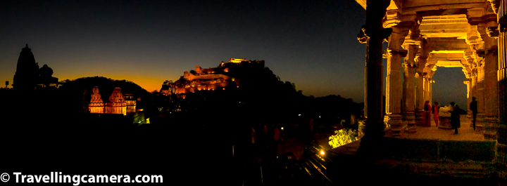 Why Neelkanth Mahadev Temple inside Kumbalgarh Fort is best place to see evening lighting?   Just after sunset (at around 6pm), lights are switched on for 15 mins at Kumbalgarh Fort and Neelkanth Mahadev temple is best place to have a panoramic view of whole fort and surrounding temples. Above photograph shows panorama of Vedi temple on left, then Badal Palace and main fort on the top and pillars of Mahadev temple on right. So if you go to the fort to see evening lighting, just go to the Neelkanth Mahadev temple and enjoy views of the fort. Since you only get 15 mins, enjoy views from here and if you feel if you have more time, go to Vedi temple and take stairs to go to the wall from where you get beautiful view of Neelkanth Mahadev temple with evening lights on it. Pillars of Neelkanth Mahadev temple stand out beautifully in evening light at Kumbalgarh Fort.