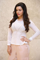Kyra Dutt in Tight White Top Trousers at Paisa Vasool audio success meet ~  Exclusive Celebrities Galleries 025.JPG