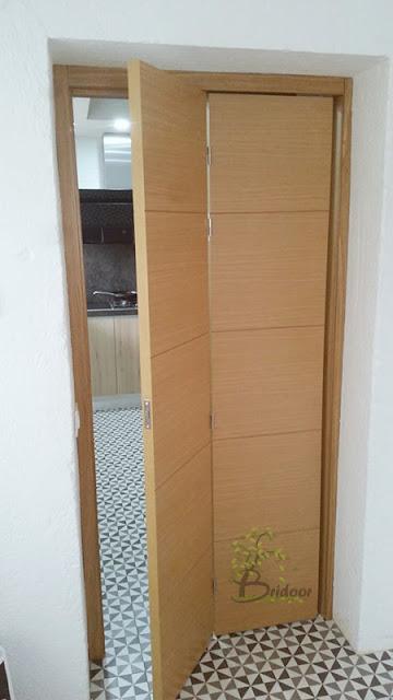 Puerta plegable madera espacios pequeños