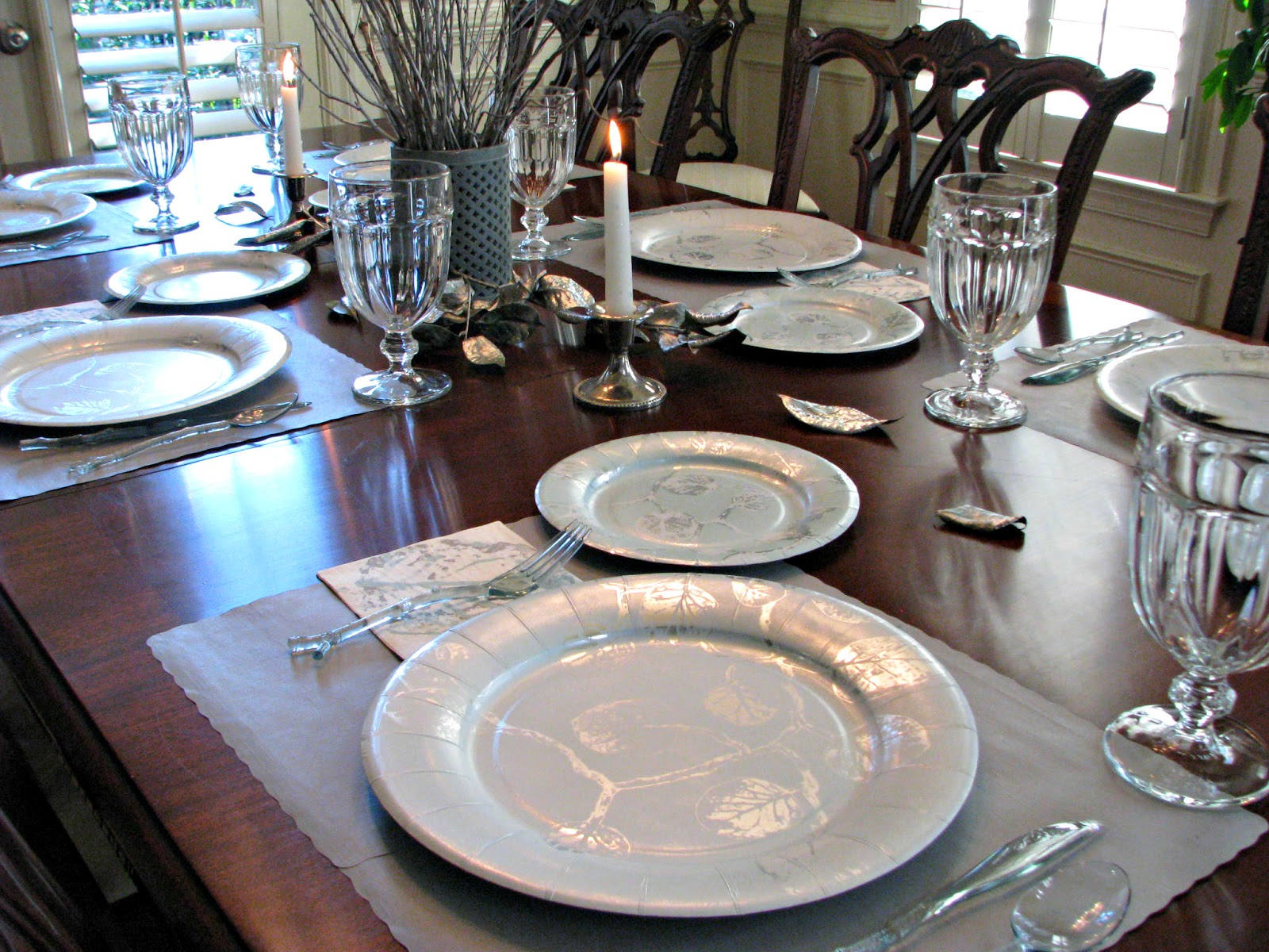 Table set in a silver and teal nature theme