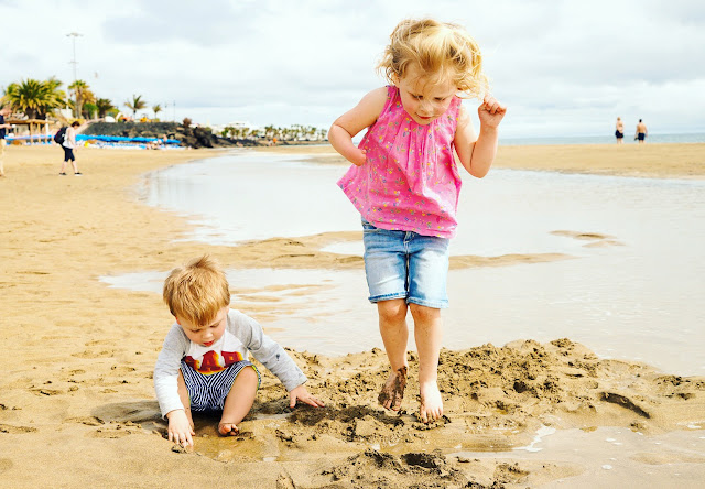 Tropical Island Playa Blanca Review, kids playing in the sand