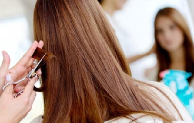 Runtin melakukan potong ujung rambut