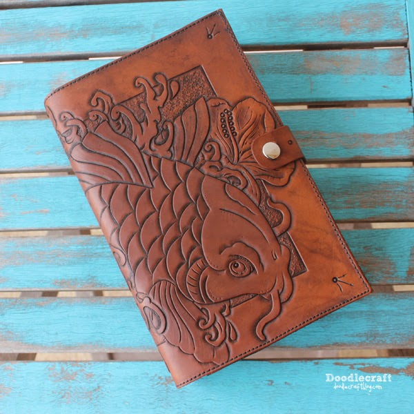 carved tooled leather book cover with asian koi