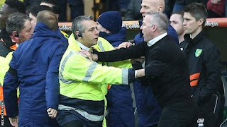 Paul Lambert was calmed down by stewards and a police officer after clashing with Norwich's coaching staff at the end of the first half