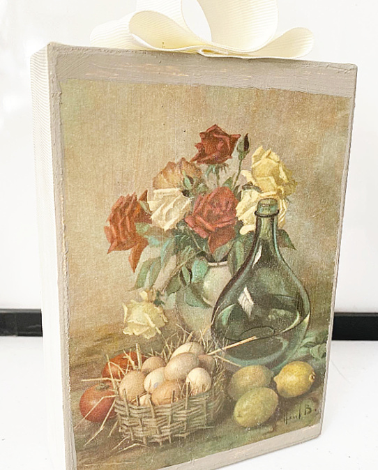 artwork on box with bow on top