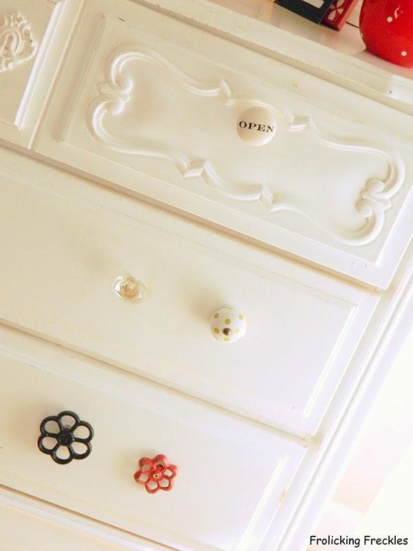 Whimsical door knobs on a bedroom dresser