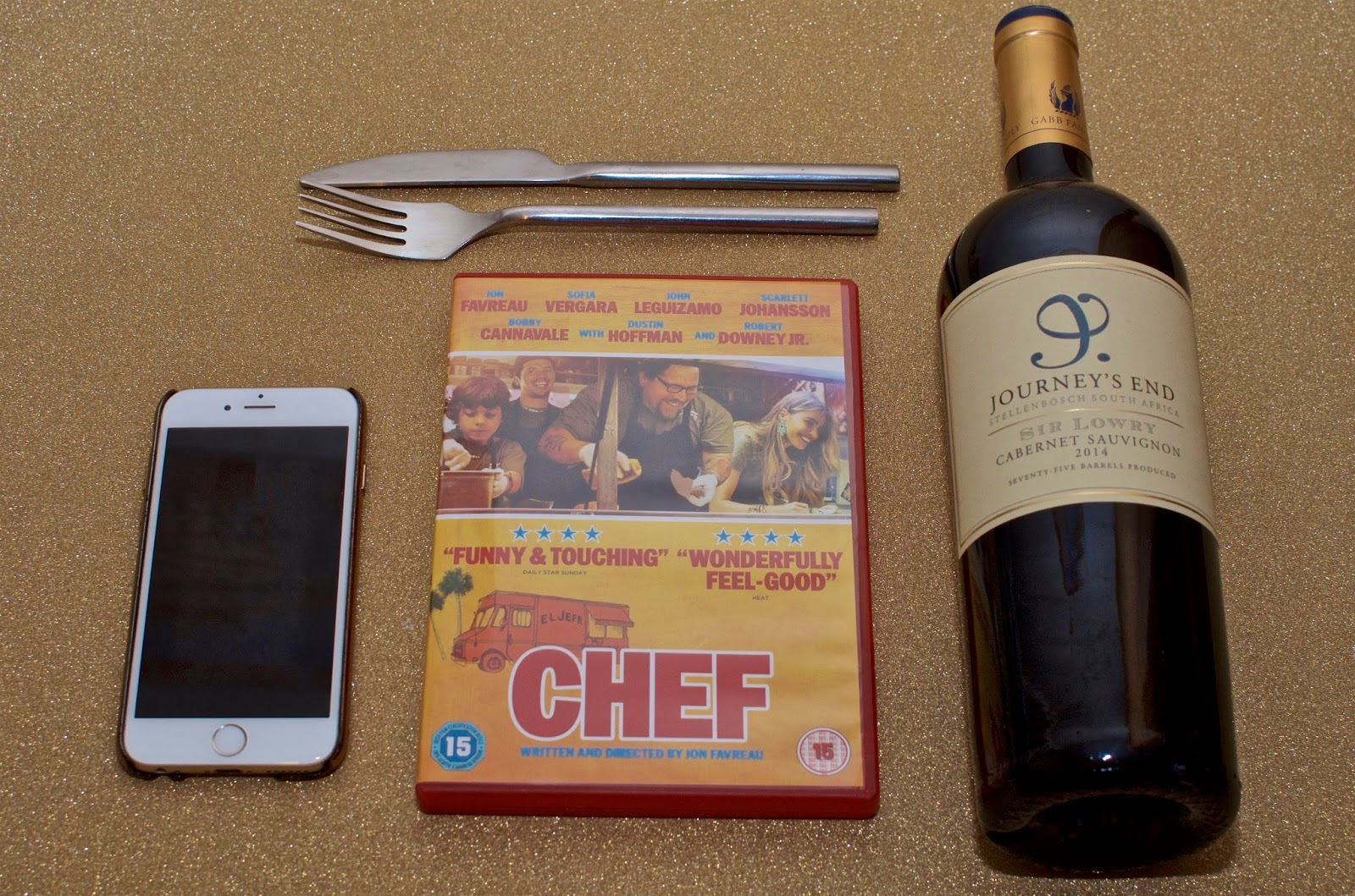 iPhone 6, DVD and red wine
