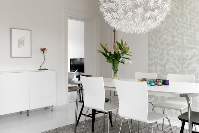 bo-laget dot se dining room with oversized ikea paper chandelier, gray and white walls, a white table surrounded by white and black