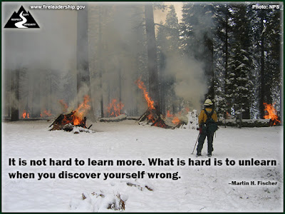 It is not hard to learn more. What is hard is to unlearn when you discover yourself wrong. – Martin H. Fischer (Firefighter burning a brush pile in the snow)
