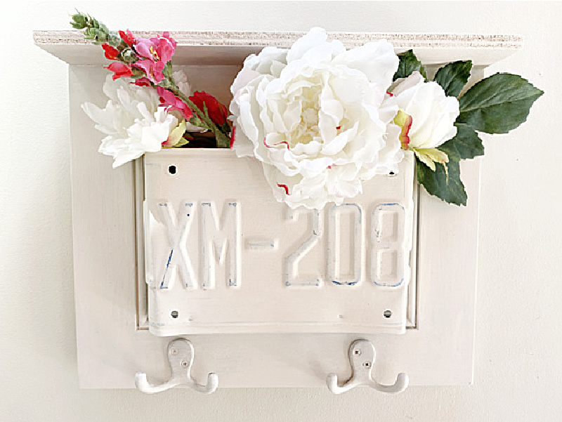 license plate shelf with flowers and hooks