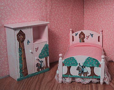 miniature dresser with picture of Rapunzel; also a miniature bed