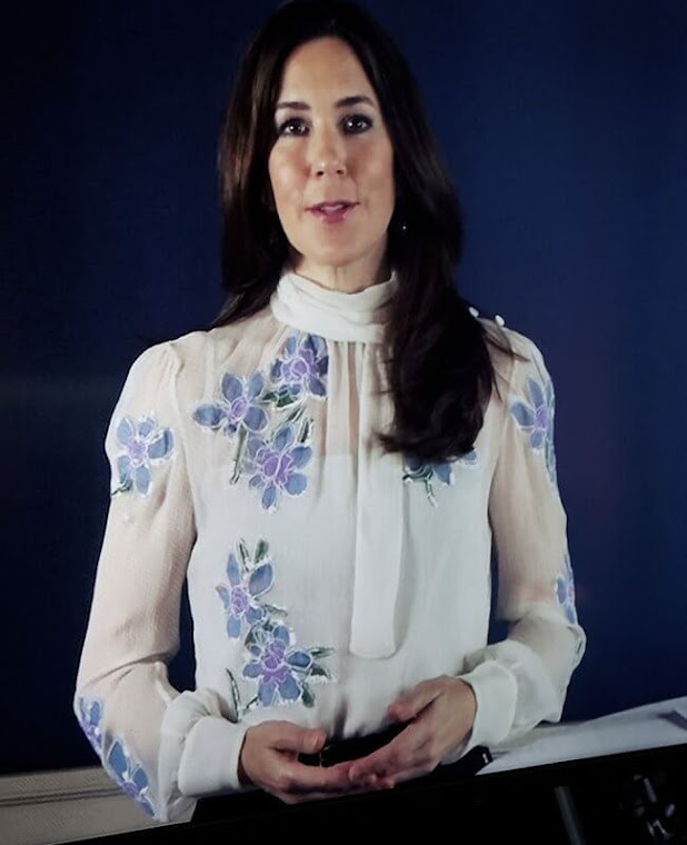 Crown Princess Mary wore a light blue floral embroidered chiffon pussy-bow blouse from Prada