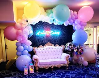 Baby shower backdrop, balloons, royal sofa