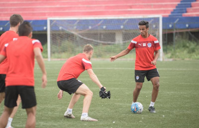 Bengaluru FC defenders Gursimrat Singh and John Johnson in training at the Bangalore Football Stadium, in Bengaluru, on Tuesday.