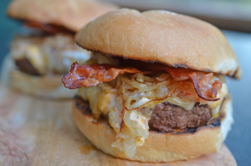 Certified Angus Beef burger topped with pimento cheese, sauteed onions, and homecured bacon.